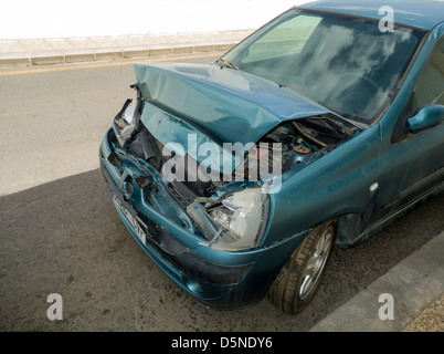 Badly damaged front of car, the result of a front-end accident. Bonnet, hood, and engine crushed - Stock Image