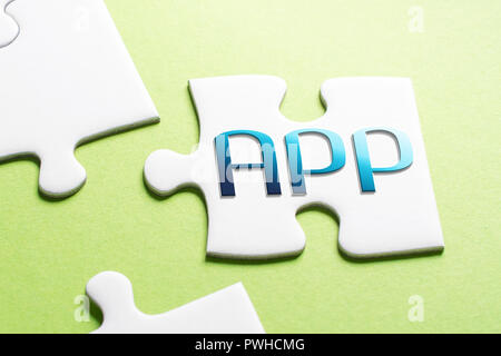 The Word App In Missing Piece Jigsaw Puzzle - Stock Image