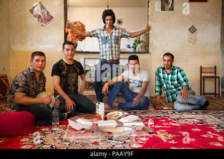 Qashqai young guys living in a city with modern fashion clothes, nomad people, Iran - Stock Image