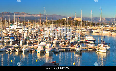 Antibes waterfront and Port Vauban harbor panoramic view, Alps background, Southern France - Stock Image