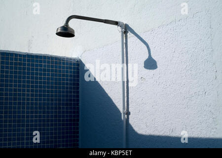 Outdoor shower by a pool at Hotel Ninays in Lloret de Mar, Spain - Stock Image