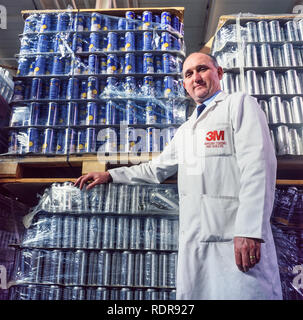 An employee at the 3M adhesive plant at Gorseinon Rd, Penllergaer, Swansea, Wales in 1988. - Stock Image