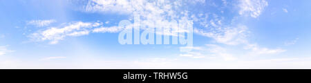 Bright blue cloudy sky at the horizon. Long panoramic view - Stock Image