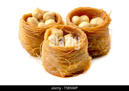 Bird nest baklava with nuts on a white background - Stock Image