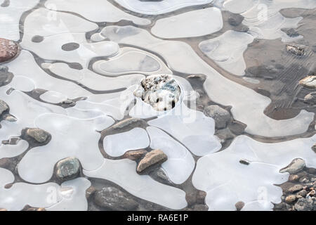 Stirlingshire, Scotland, UK. 2nd Jan, 2018. UK Weather: Frozen puddle on a very cold morning in Stirlingshire, Scotland Credit: Kay Roxby/Alamy Live News - Stock Image