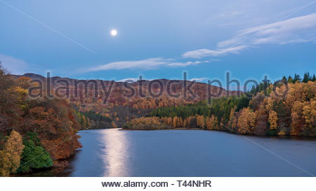 The hydro-electric dam above Pitlochry in Perthshire in early morning moonlight, Scotland - Stock Image