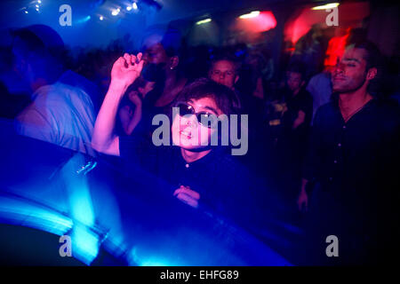 Japanese guy dancing at The End nightclub. - Stock Image