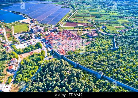 Town of Ston bay and salt fields aerial view, Peljesac peninsula, Dalmatia region of Croatia - Stock Image