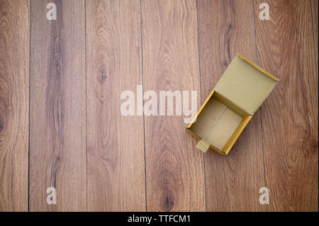 box empty open cardboard box on wooden surface with empty space top Flat lay - Stock Image