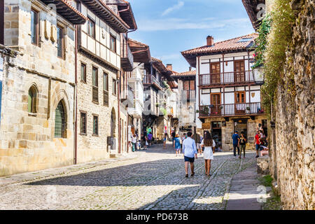 Santillana, Spain - 8th July 2018: Tourists walking around the town. There are many historic buildings - Stock Image