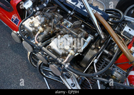 Weber carburretors attached to the engine of a classic open wheeler racing car. - Stock Image