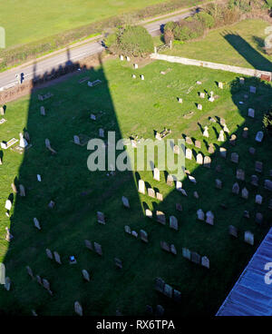 A shadow of the parish Church of St Nicholas on the churchyard at Blakeney, Norfolk, England, United Kingdom, Europe. - Stock Image
