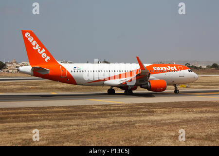 Airbus A320 jet plane belonging to easyJet Europe, a subsidiary of low cost airline EasyJet, on arrival in Malta. British airlines, the EU and Brexit. - Stock Image