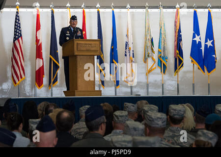 U.S. Air Force Gen. Terrence J. O'Shaughnessy, commander of United States Northern Command and North American Aerospace Command, speaks during a change of command ceremony for Alaskan North American Aerospace Defense Command, Alaskan Command, and the Eleventh Air Force at Joint Base Elmendorf-Richardson, Alaska, Aug. 24, 2018. U.S. Air Force Lt. Gen. Tom Bussiere assumed command from Air Force Lt. Gen. Ken Wilsbach. Family, friends, Arctic warriors and civic leaders from the surrounding communities attended the ceremony that was jointly-officiated by O'Shaughnessy and U.S. Air Force Gen. Charl - Stock Image