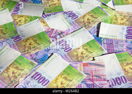 Collection of the Swiss 1000 franks banknotes. 1000 franks note issued by Swiss National Bank (SNB) is one of the most valueable banknotes in the worl - Stock Image