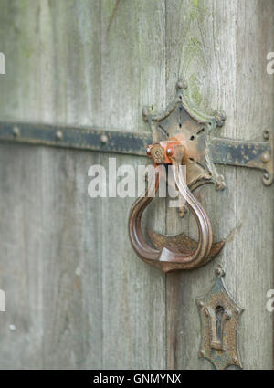 Wooden door with metal handle and lock detail. Part of the old St Michael and All Angels Church in Stourport. - Stock Image