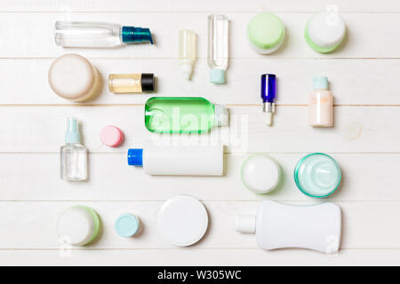 Group of plastic bodycare bottle Flat lay composition with cosmetic products on wooden background empty space for you design. Set of White Cosmetic co - Stock Image