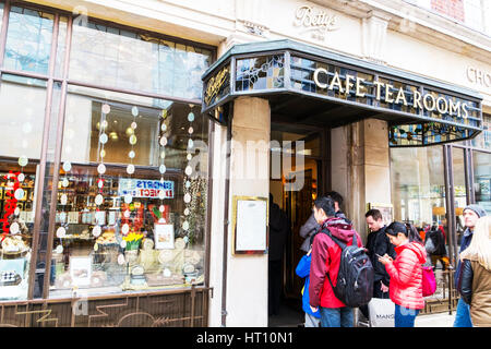 Bettys Café Tea Rooms customers queue queuing outside shop waiting for bettys famous tea room York city centre - Stock Image