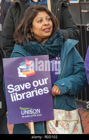 London, UK. 3rd Nov, 2018. People gather at the British Library for a march and rally against cuts in library services, which are a vital part of our cultural services, especially for working class schoolchildren and young people. Over 100 libraries closed in 2017 and we need the Government to take action to stop and reverse library cuts. The event in support of libraries, museums and cultural services was organised by Unison and supported by PCS and Unite. Unfortunately I had to leave before the march to a rally at Parliament began. Credit: Peter Marshall/Alamy Live News - Stock Image