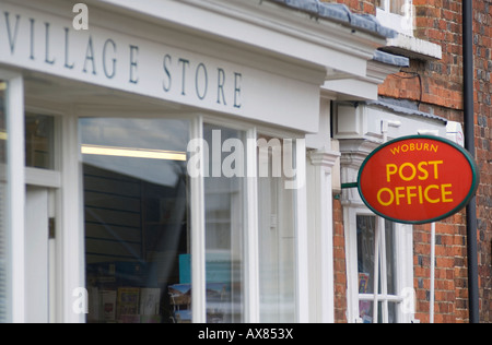 rural village post office at Woburn old post box Save our post office - Stock Image