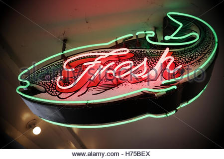 Illuminated fish light for a sea food market stall at Pike Place Market, Seattle, Washington State, north west USA. - Stock Image