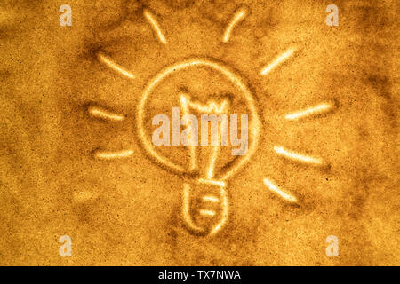 Sand animation, light bulb. the concept of ideas and inspiration - Stock Image