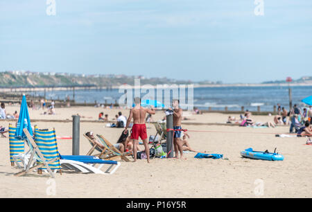 Bournemouth, UK. 11th June 2018. Tourists enjoy the hot and sunny weather on Bournemouth beach and seafront. Credit: Thomas Faull/Alamy Live News - Stock Image
