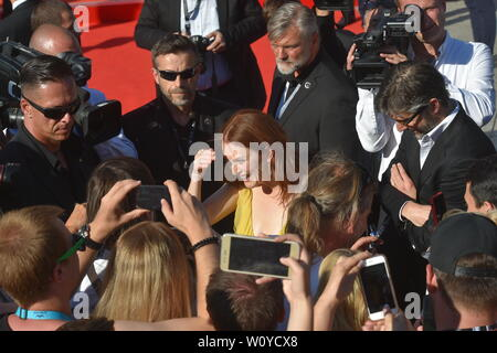 Karlovy Vary, Czech Republic. 28th June, 2019. US actress Julianne Moore, centre, and her husband, scriptwriter and director Bart Freundlich, right, arrive to the opening ceremony of the 54th Karlovy Vary International Film Festival begins on June 28, 2019, in Karlovy Vary, Czech Republic. Credit: Slavomir Kubes/CTK Photo/Alamy Live News - Stock Image