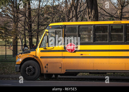 MONTREAL, CANADA - NOVEMBER 4, 2018: North American Yellow School Bus parked, waiting for students, with the text translated in French, according to F - Stock Image