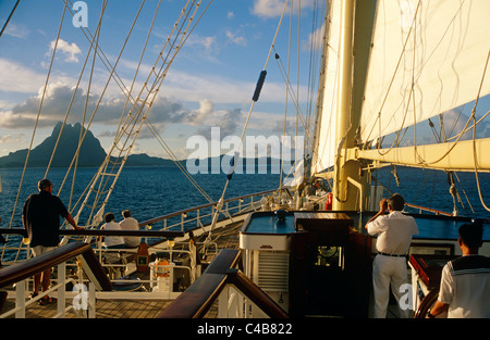 French Polynesia, Society Islands, Leeward Islands, Bora Bora (aka Pora Pora). The Star Flyer, a barquentine, approaches - Stock Image
