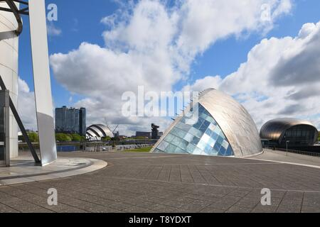 A riverside view of science centre, imax theatre, armadillo, and Finnieston crane from the bottom of the Glasgow Tower platform, in Scotland, UK - Stock Image