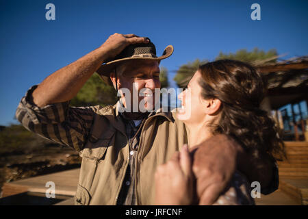 Couple having fun during safari vacation - Stock Image