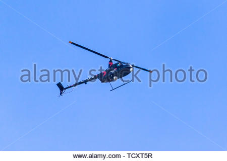 Global News helicopter flying over the city.  Global News is part of  Global Television Network which is owned by Corus Entertainment - Stock Image