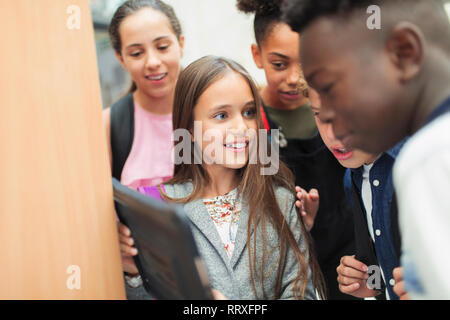 Junior high students using digital tablet - Stock Image