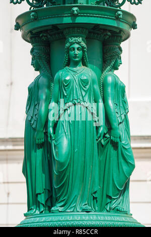 Art Nouveau image, view of caryatids at the base of a green Art Nouveau / Secession styled street light in the Hradcany Castle district of Prague. - Stock Image