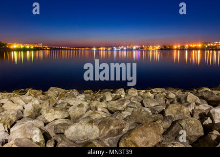 Night time Liverpool city reflections in to the Merseyside River - Stock Image