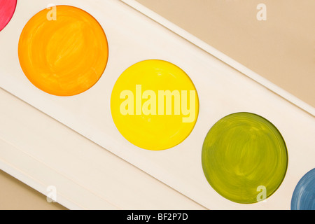 Palette of watercolor paints mounted on a wall - Stock Image