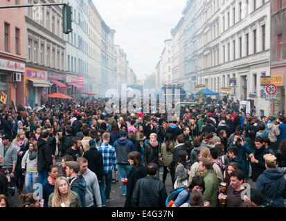 People listening to a sound system in the street on May Day in Berlin Germany - Stock Image