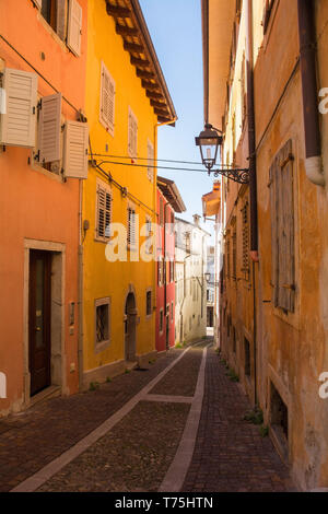 An historic street in the north eastern Italian city of Gorizia in the Friuli Venezia Giulia region. The street leads to the historic Cocevia part of  - Stock Image