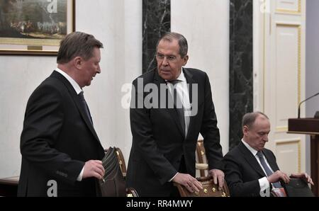 Moscow, Russia. 22nd Feb, 2019. Russian Foreign Minister Sergei Lavrov, center, chats with Special Presidential Representative for Environmental Protection, Ecology and Transport Sergei Ivanov, left, before the start of the permanent members of the Security Council of the Russian Federation meeting at the Kremlin February 22, 2019 in Moscow, Russia. Security Council Secretary Nikolai Patrushev is seated to the right. Credit: Planetpix/Alamy Live News - Stock Image