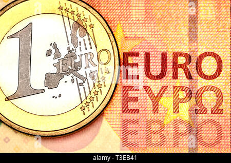 1 Euro coin on a 10 Euro note - Stock Image