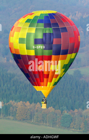Aerial view of a hot air balloon in flight - Stock Image