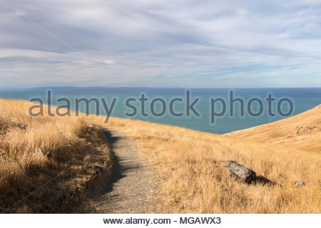 Sunset on hills with ocean view, Christchurch, New Zealand - Stock Image