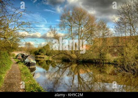 Narrow boats moored on the Grand Union Canal, near Stockers Lock, Rickmansworth, Hertfordshire, England, UK - Stock Image