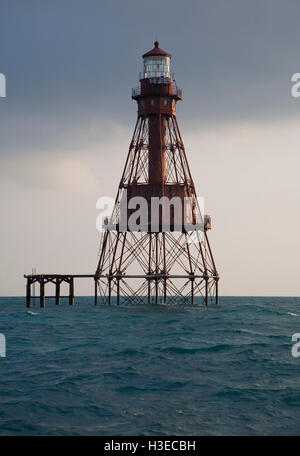 Florida's American Shoal Lighthouse off Sugarloaf Key  in a peaceful image catching the light of dawn on a hazy - Stock Image