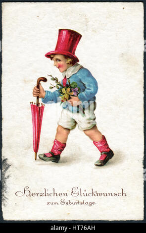 GERMANY - CIRCA 1934: A greeting postcard printed in Germany, shows a boy with flowers. The inscription in German: - Stock Image