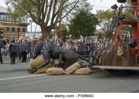Xolo the dog takes a rest during the Giants Spectacular parade through Liverpool city centre UK - Stock Image