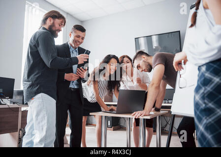 Portrait of creative team talking in office on meeting. - Stock Image