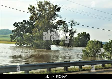 An area of Leon, Wis., shows flooding Aug, 28, 2018 in Monroe County, Wis. Firefighters with the Directorate of Emergency Services Fire Department at Fort McCoy, Wis., helped with rescue operations for the flooding. On Aug. 27 to early Aug. 28, 2018, 5-12 inches of rain fell on several areas of Monroe County, causing flash flooding and stranding residents in flooded areas. Fort McCoy firefighters helped with the rescue of people in the affected areas. (U.S. Army Photo by Scott T. Sturkol, Public Affairs Office, Fort McCoy, Wis.) - Stock Image