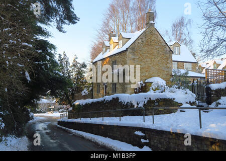 Detached house in the Oxfordshire village of Hook Norton in the aftermath of a severe snowfall - Stock Image